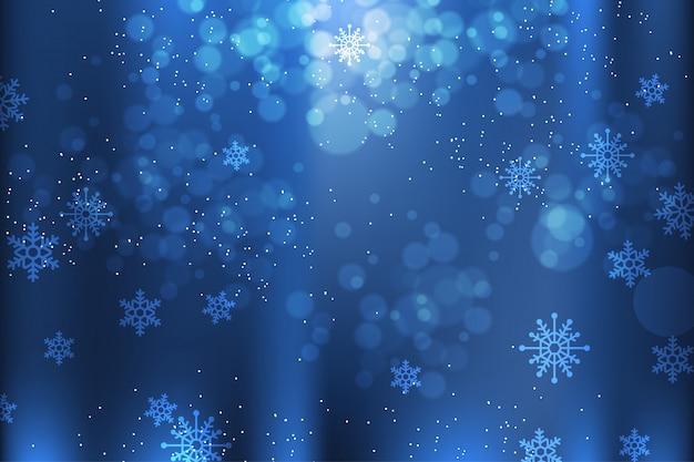 Blauer winterhintergrund mit schneeflockenelementen Premium Vektoren
