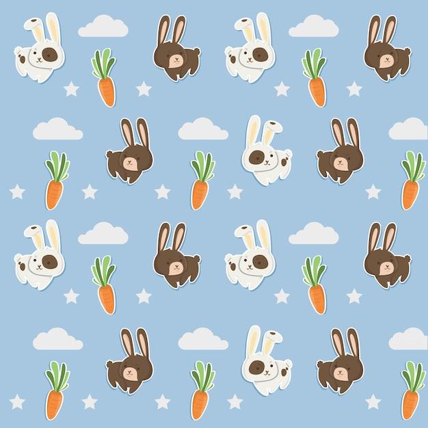 Blaues nettes kaninchen und karotten des musters. Premium Vektoren