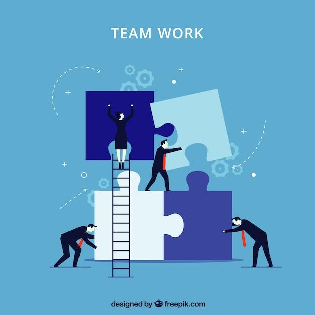Blaues Teamwork-Konzept mit Puzzlestücken Kostenlose Vektoren