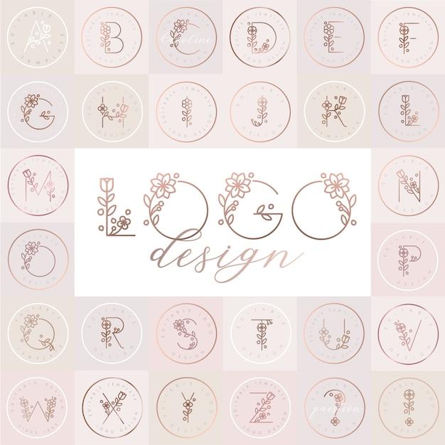 Blumenalphabet mit editierbaren logo-designvorlagen Premium Vektoren