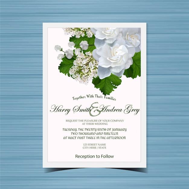 Blumenhochzeits-einladung mit schönen weißen blumen Premium Vektoren