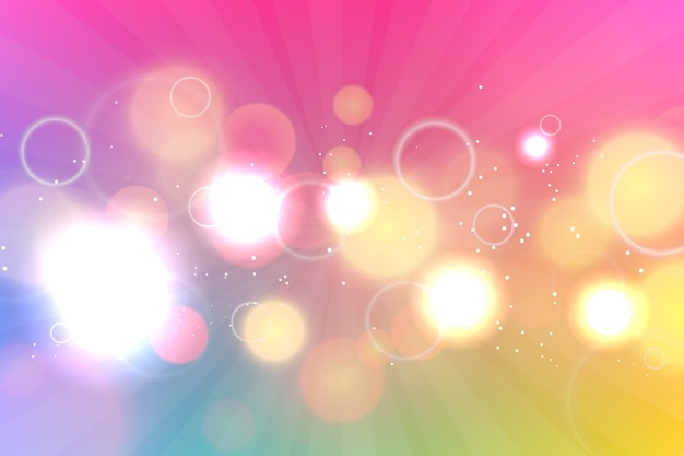 Bokeh-effekt-hintergrund mit farbverlauf Kostenlosen Vektoren