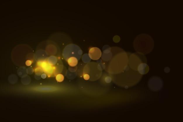 Bokeh-lichteffekt auf dunklen hintergrund Kostenlosen Vektoren