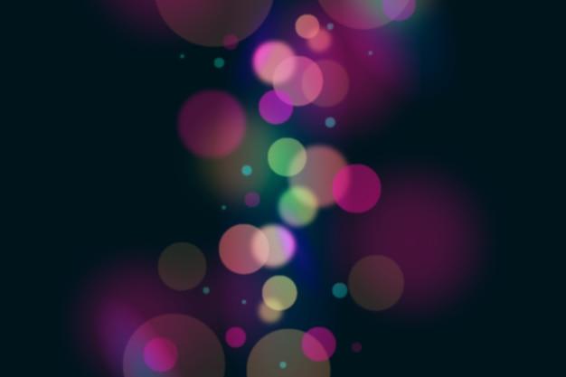 Bokeh lichteffekt hintergrund dunkel Kostenlosen Vektoren