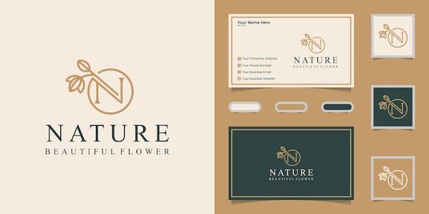 Buchstabe n natur- und blattlogoschablone und visitenkarte Premium Vektoren