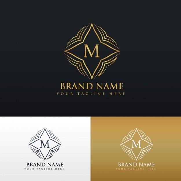 Buchstaben m goldene linie kunst-monogramm-logo Kostenlosen Vektoren