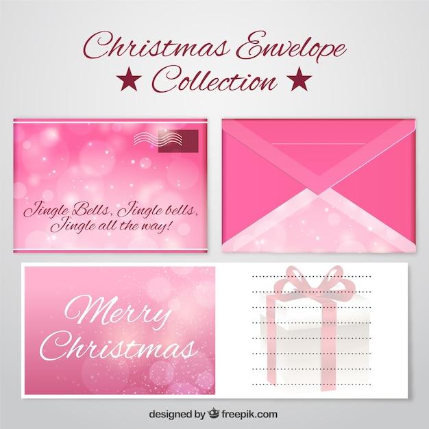Buchstaben und leuchtend rosa Umschläge für frohe Weihnachten und ...