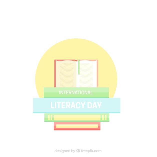 Bücher auf gelbem kreis alphabetisierung tag zu feiern Kostenlosen Vektoren