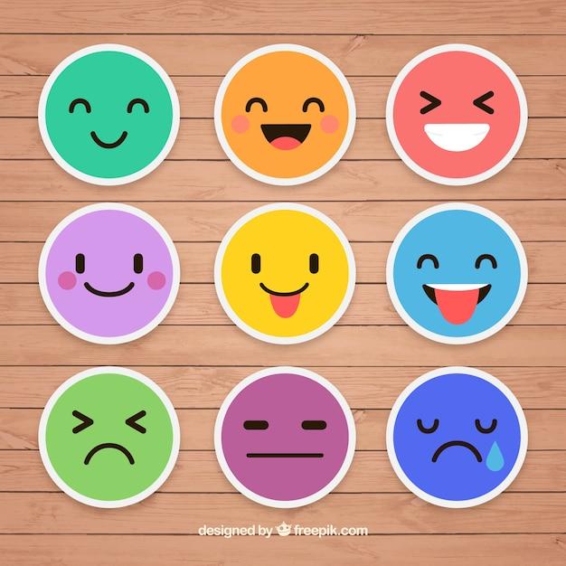 Bunte aufkleber von emoticons Kostenlosen Vektoren