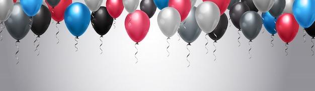 Bunte ballon-dekoration über schablonen-horizontalem hintergrund Premium Vektoren