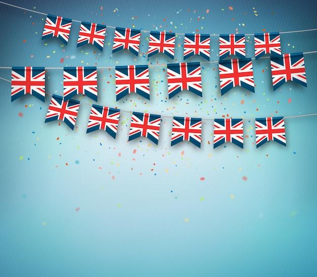 Bunte flaggen von großbritannien, vereinigtes königreich mit konfettis auf blauem hintergrund. Premium Vektoren