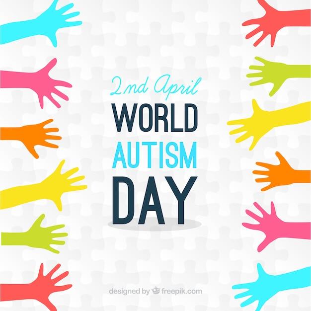 Bunte hände autismus tag hintergrund Kostenlosen Vektoren