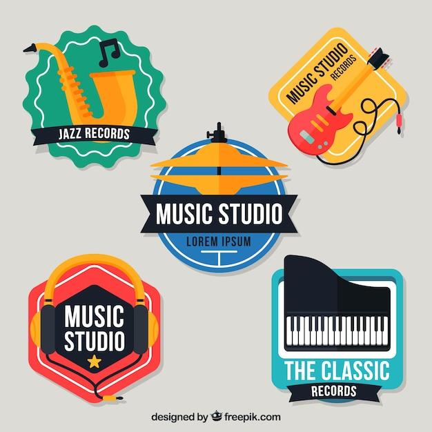 Bunte logos für ein musikstudio Kostenlosen Vektoren