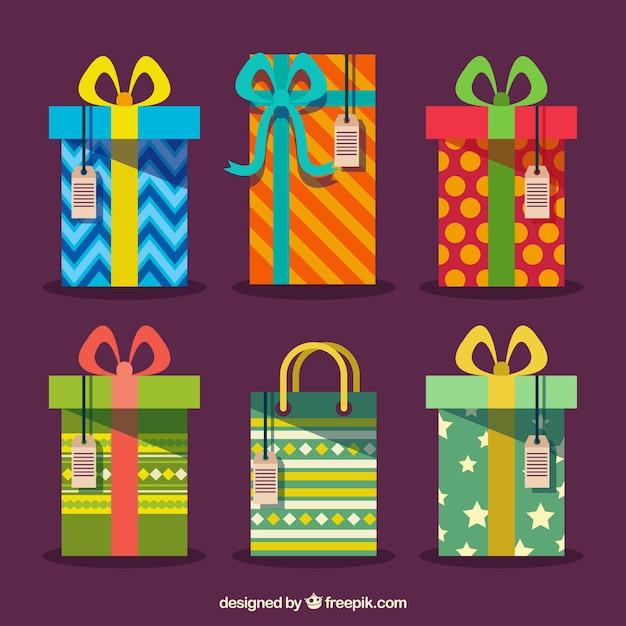 Kostenlose Weihnachtsgeschenke.Bunte Weihnachtsgeschenke Mit Tags Hängend Download Der