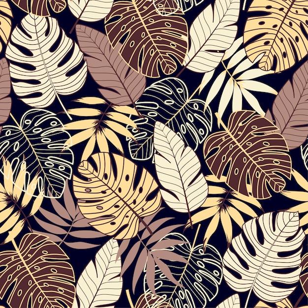 Buntes nahtloses muster mit tropischen pflanzen auf dunklem hintergrund Premium Vektoren