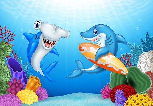 Cartoon haie mit tropischen unterwasser hintergrund Premium Vektoren