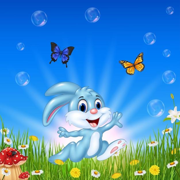 Cartoon-kaninchen mit schmetterling Premium Vektoren