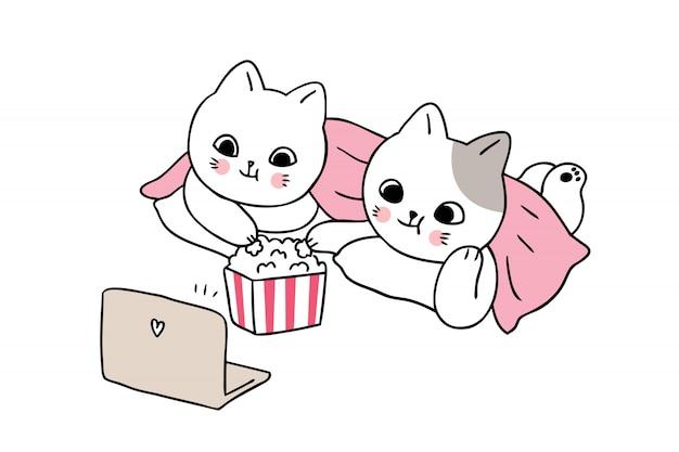 Cartoon süße katzen schauen film. Premium Vektoren