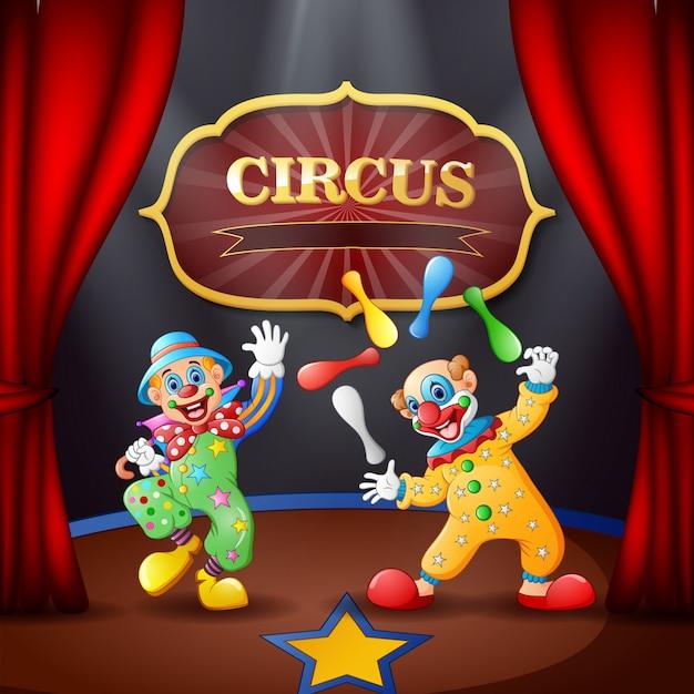 Cartoon-zirkusshow mit clowns auf der bühne Premium Vektoren