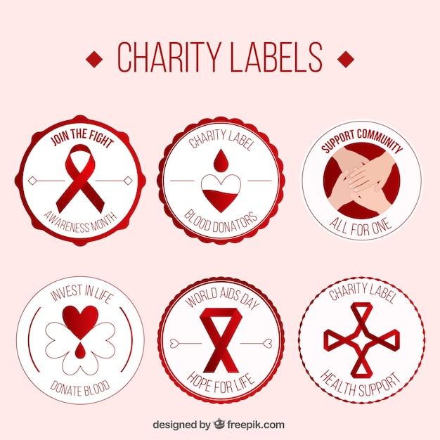 Charity-etiketten von blutspender Kostenlosen Vektoren