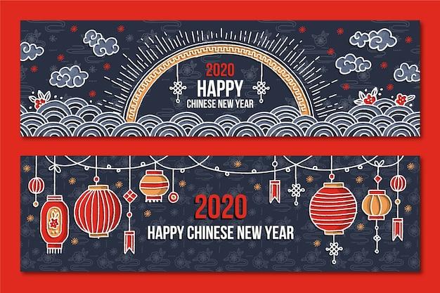Chinesische von hand gezeichnete fahnen des neuen jahres Kostenlosen Vektoren