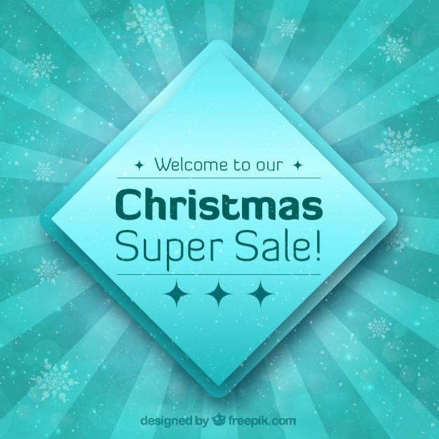 Christmas sale badge auf einem blauen hintergrund Kostenlosen Vektoren