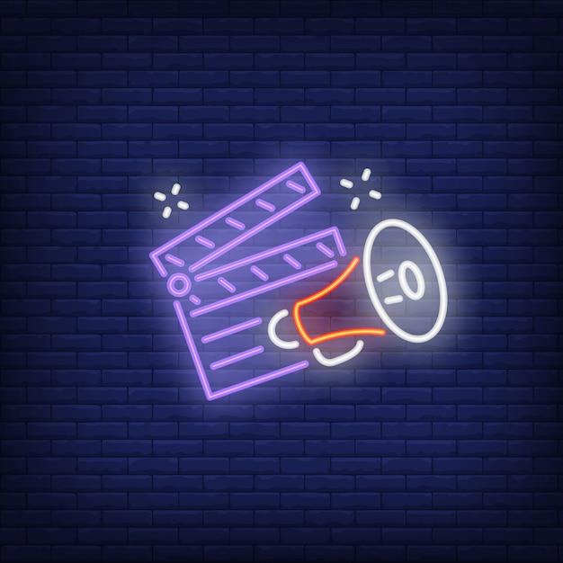 Clapper board und megaphon leuchtreklame Kostenlosen Vektoren