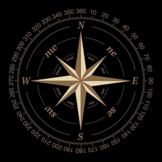 Compass auf einem schwarzen hintergrund Kostenlosen Vektoren