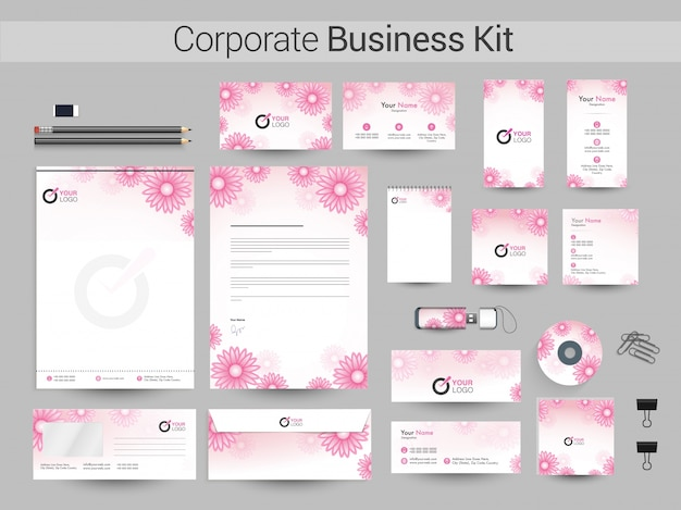 Corporate business kit mit rosa blüten. Premium Vektoren