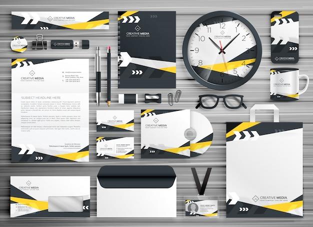 Corporate identity briefpapier vorlage design mit abstrakten gelben schwarzen formen gesetzt Premium Vektoren