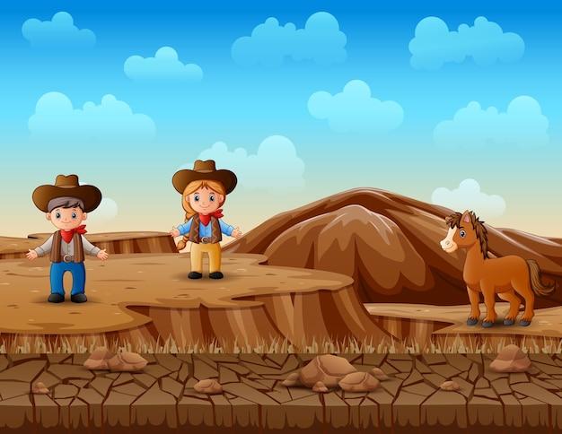 Cowboy und cowgirl in der wüstenlandschaft Premium Vektoren