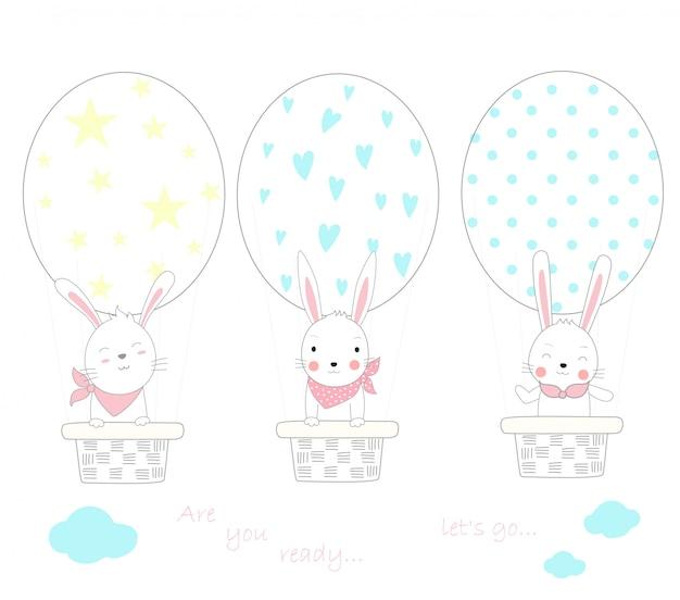 Das niedliche babykaninchen mit eiform-ballonluft Premium Vektoren