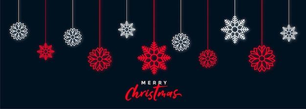 Dekorative dunkle weihnachtsschneeflocken-festivalfahne Kostenlosen Vektoren
