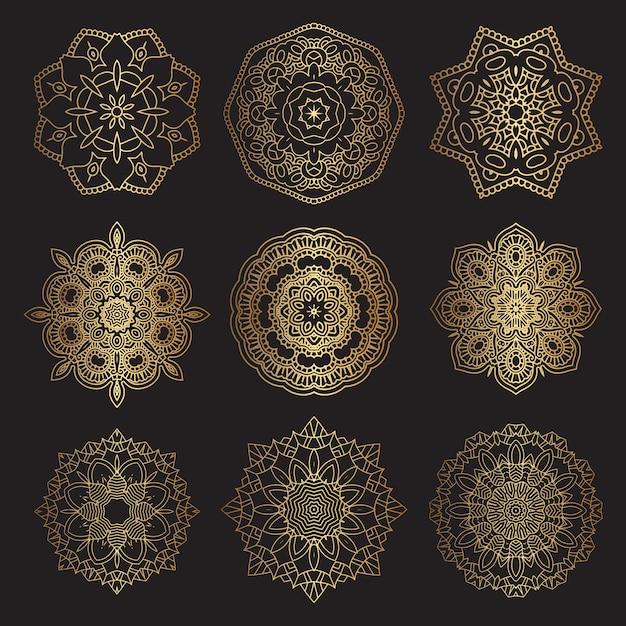 Dekorative mandala-designs in gold und schwarz Kostenlosen Vektoren
