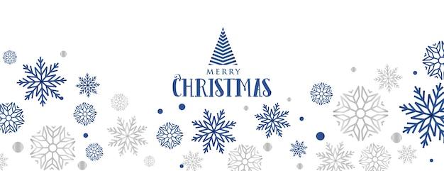 Dekoratives banner der schneeflocken für das frohe weihnachtsfest Kostenlosen Vektoren