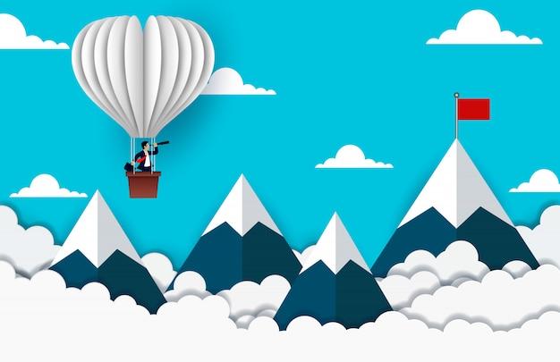 Der geschäftsmann, der auf dem ballon schaut mit dem fernglas steht, gehen zur roten fahne auf himmel zwischen berg Premium Vektoren