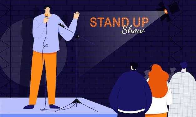 Der junge männliche standup-comedian begrüßt sein publikum zu beginn der show und spricht direkt mit den menschen über ein mikrofon. monolog von humorvollen geschichten, witzen und onelinern Premium Vektoren