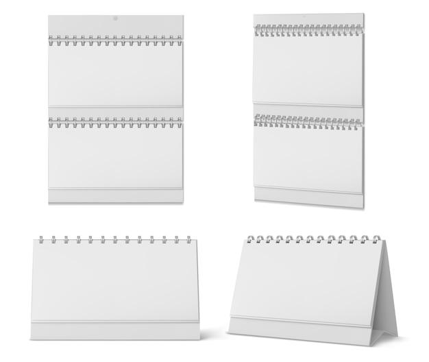 Desktop- und wandkalender mit spiralförmigen und leeren seiten auf weißem hintergrund. realistisches modell des weißen papierkalenders, des büroplaners oder des notizblocks, die auf tisch stehen oder an wand hängen Kostenlosen Vektoren