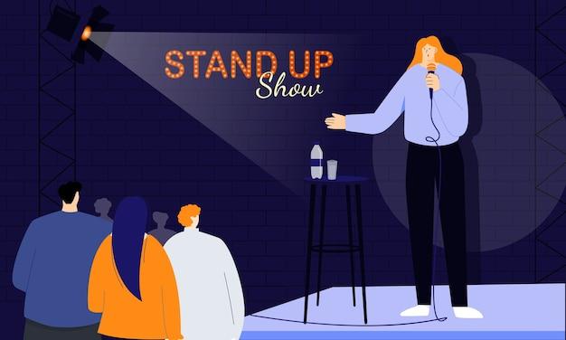 Die junge komikerin begrüßt ihr publikum zu beginn der show und spricht direkt mit den menschen über ein mikrofon. monolog von humorvollen geschichten, witzen und onelinern Premium Vektoren