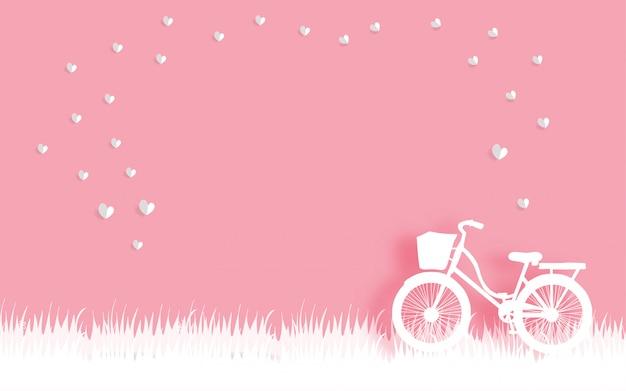 Die karte des valentinsgrußes mit in fahrrad und in sich schwimmendem herzen im papier schnitt artvektorillustration Premium Vektoren