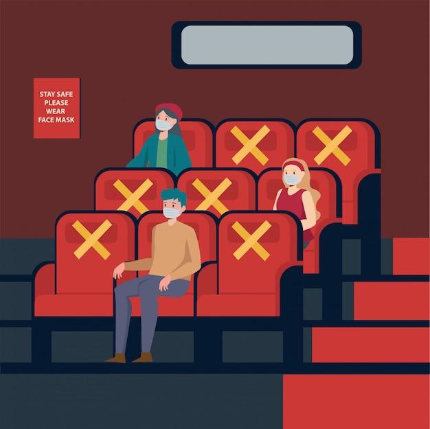 Die leute schauen sich im theater filme an, halten abstand und benutzen eine medizinische maske Premium Vektoren