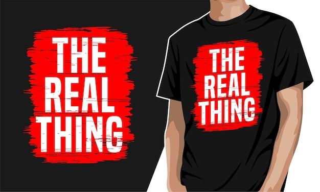 Die reale sache - typografie-grafik-t-shirt für druck Premium Vektoren