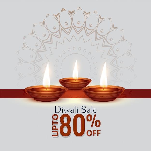 Diwali-festivalverkaufshintergrund mit drei diya Kostenlosen Vektoren