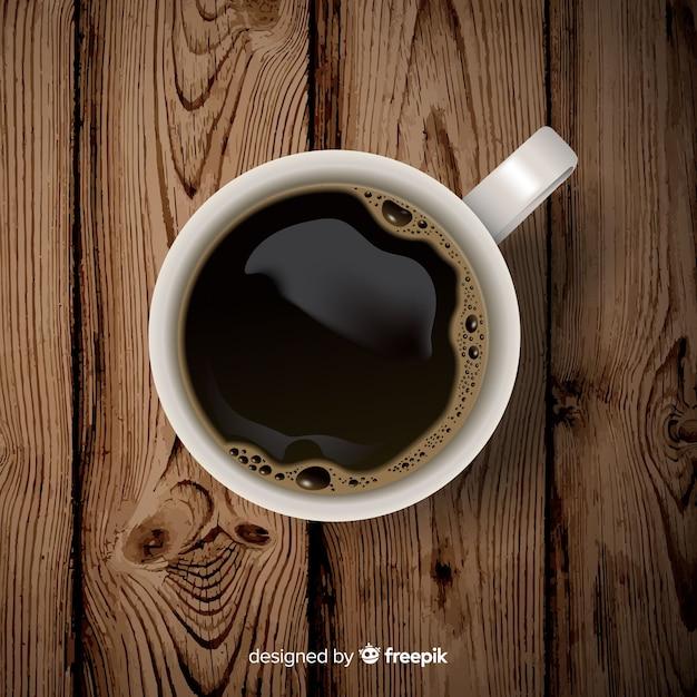 Draufsicht der kaffeetasse mit realistischem design Kostenlosen Vektoren