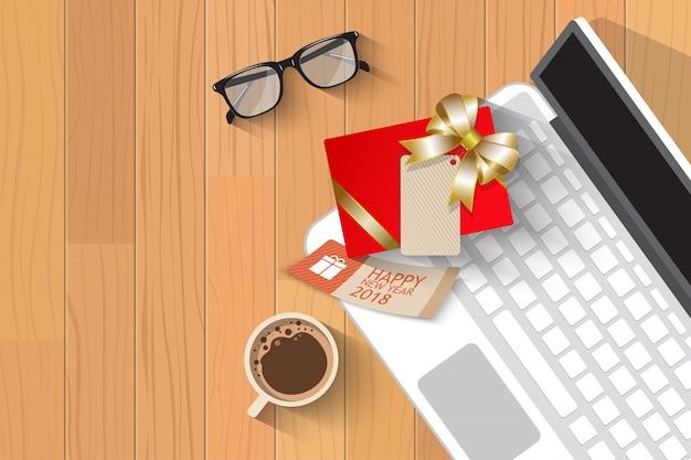 Draufsichtweihnachtsgeschenk über laptop Premium Vektoren