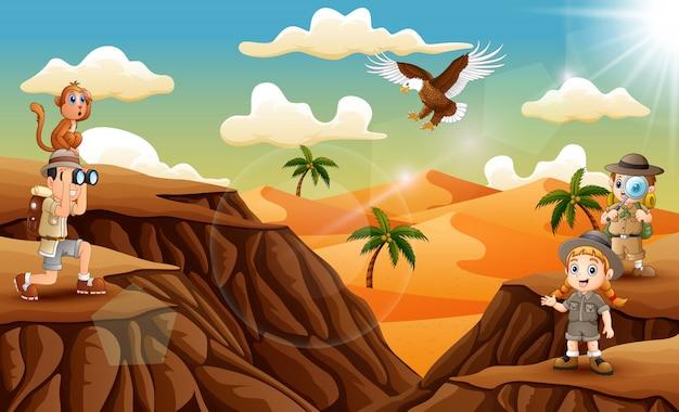 Drei forscher kind in der wüste Premium Vektoren