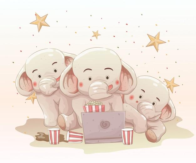 Drei nette elefanten, die zusammen film auf laptop aufpassen. vektor cartoon hand gezeichnet Premium Vektoren