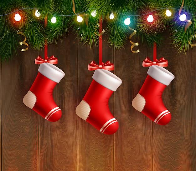 Drei rote weihnachtsstrümpfe Kostenlosen Vektoren