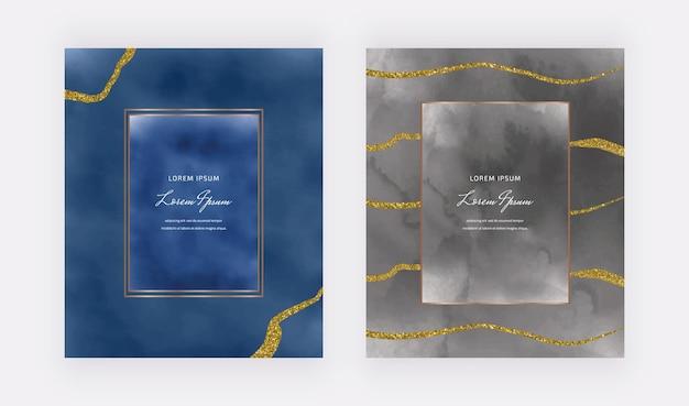 Dunkelblaue und schwarze aquarellkarten mit geometrischen rahmen und goldenen glitzerlinien Premium Vektoren