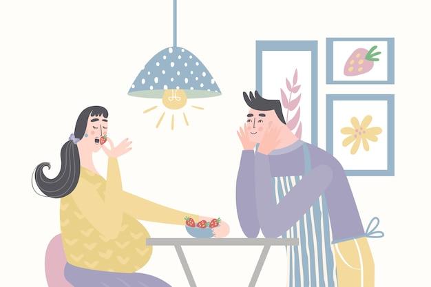 Ehemann füttert schwangere frau. gesunde ernährung für schwangere frau. Premium Vektoren